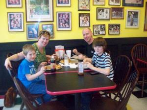 Family enjoying pizza.